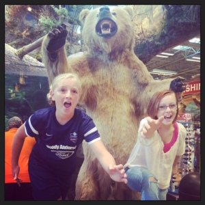 "The girls ""running"" from the bear at Bass Pro Shop Saturday night!"